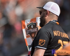 a fan During a match between the Houston Dynamo vs San Jose Earthquakes, Goals from Houston Dynamo Forward Erick Torres #9and Houston Dynamo Forward Alberth Elis #17 Would earn the dynamo a win by a score of 2 to 0.April 22,2017 BBVA Compass Stadium