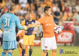 Houston Dynamo Forward Erick Torres #9 shakes New York Red Bulls Goalkeeper Luis Robles #31 before taking a penalty kick in the first half of a match between the Houston Dynamo vs The New York Red bulls April 1,2017 BBVA Compass Stadium