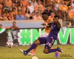 Houston Dynamo Forward Alberth Elis #17 dribbles the ball past Orlando City Soccer Club Defender Tommy Redding #29 During a match between the Houston Dynamo vs Orlando City SC,Week 10 of the MLS.Houston Tx.2017