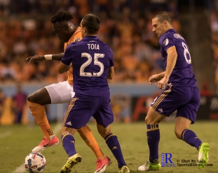 Houston Dynamo Forward Alberth Elis #17 controls the ball past Orlando City Soccer Club Midfielder/Defender Donny Toia #25 During a match between the Houston Dynamo vs Orlando City SC,Week 10 of the MLS.Houston Tx.2017