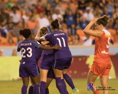Orlando Pride teammates celebrate During a match between the Houston Dash vs Orlando Pride Final Score Dash 2,Orlando 4 ,Houston Tx, 2017.