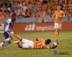 Houston Dynamo Forward Romell Quioto #12 grabs the ball with his hands after F.C Dallas Midfielder Carlos Gruezo #7 Draws a fouled During a match between the Houston Dynamo vs Dallas FC,June 23,2017 Houston Tx.