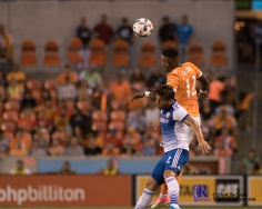 Houston Dynamo Forward Romell Quioto #12 heads the ball from F.C Dallas DefenderAubrey David #2 During a match between the Houston Dynamo vs Dallas FC,June 23,2017 Houston Tx.