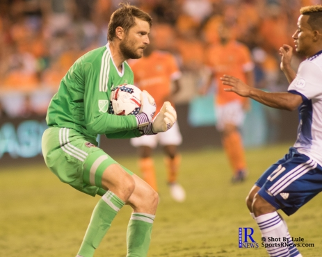 Houston Dynamo Goalkeeper Tyler Deric #1 holds his ground as F.C Dallas Midfielder/Forward Michael Barrios #21 tries to run towards the ball During a match between the Houston Dynamo vs Dallas FC,June 23,2017 Houston Tx.