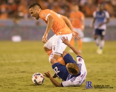 Houston Dynamo Midfielder Alex #14 gets fouled by F.C Dallas Midfielder/Forward Michael Barrios #21 During a match between the Houston Dynamo vs Dallas FC,June 23,2017 Houston Tx.